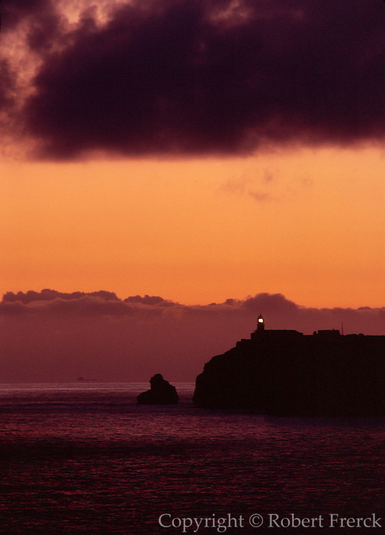 PORTUGAL, ALGARVE, SOUTH COAST Cape St. Vincent Lighthouse; at the southwestern most point in Europe, at sunset