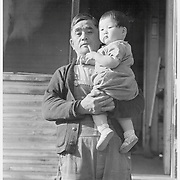Grandfather of 64 who came to the United States from Japan at the age of 19. He now lives with his daughter and son-in-law, a prosperous farm operator, but will soon be evacuated to an assembly point and later transferred to a War Relocation center for the duration. He advised his daughter that now is the time to prove their loyalty to this country. -- Photographer: Lange, Dorothea -- Mountain View, California. 4/26/42<br /> Identifier:<br /> Volume 57<br /> Identifier:<br /> Section G<br /> Identifier:<br /> WRA no. A-535<br /> Collection:<br /> War Relocation Authority Photographs of Japanese-American Evacuation and Resettlement Series 14: Preevacuation<br /> Contributing Institution:<br /> The Bancroft Library. University of California, Berkeley.