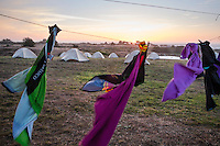 Backroads Cycling Clothes Hanging on Clothesline in Windy Weather During Sunset at Chanslor Ranch, Bodega Bay, California