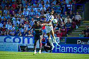 Huddersfield Town Terence Kongolo battling with Reading Andy Yiadom during the EFL Sky Bet Championship match between Huddersfield Town and Reading at the John Smiths Stadium, Huddersfield, England on 24 August 2019.