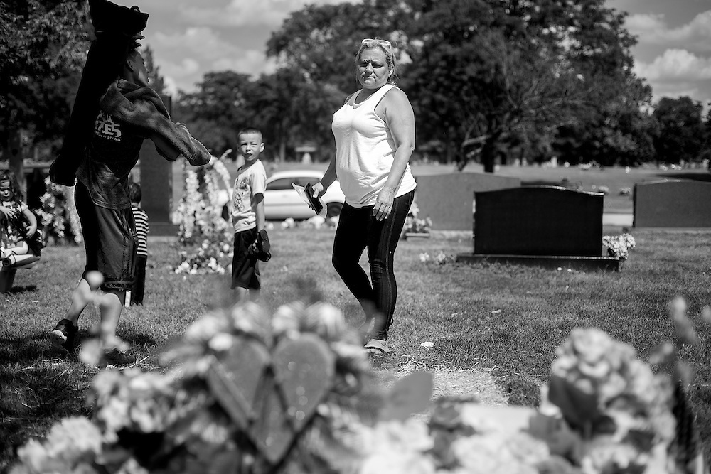 CHICAGO, IL - AUGUST 14, 2016: Diana Mercado turns back to take a last look at the gravesite of her daughter, Veronica Lopez, 15, who was shot and killed over Memorial Day weekend while riding in a car with friends. CREDIT: Sam Hodgson for The New York Times.