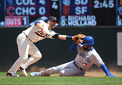 May 2, 2018 - Minneapolis, MN, U.S. - MINNEAPOLIS, MN - MAY 02: Toronto Blue Jays Outfield Teoscar Hernandez (37) is caught stealing on a throw from Minnesota Twins Catcher Jason Castro (15) to Minnesota Twins Second base Brian Dozier (2) during a MLB game between the Minnesota Twins and Toronto Blue Jays on May 2, 2018 at Target Field in Minneapolis, MN.The Twins defeated the Blue Jays 4-0.(Photo by Nick Wosika/Icon Sportswire) (Credit Image: © Nick Wosika/Icon SMI via ZUMA Press)