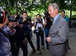 © Licensed to London News Pictures. 01/06/2017. London, UK.  Former UKIP leader Nigel Farage is seen surrounded by media in London.  He has said that he doubts that the FBI are going to name him as a 'person of interest' in their investigation into Russian involvement in the U.  S.   election. Photo credit: Ben Cawthra/LNP