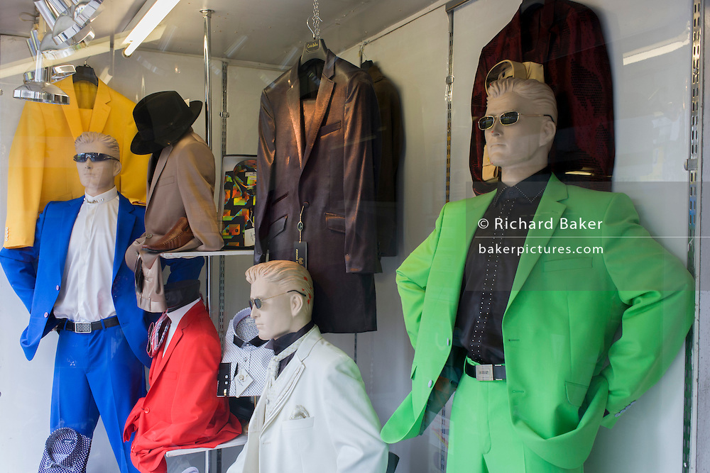 Multi-coloured mens' jackets in a Brixton shop window in south London.