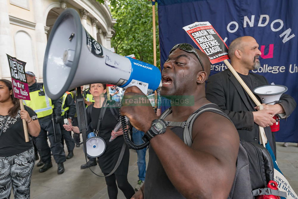 June 24, 2017 - London, United Kingdom - Several hundred attended Unite Against Fascism's protest against the EDL, some gathering on the corner of Northumberland Avenue close to the advertised WDL meeting point at Charing Cross where only a handful of the EDL turned up, with rather more meeting at the Wetherspoons on Whitehall. There were a few minor scuffles with EDL protesters on their way to the pub, but several hundred police kept the two groups apart, moving the UAF down to their assigned rally point on the Embankment before escorting the EDL to another location a couple of hundred yards away. After the EDL had been escorted back to the station, the UAF marched to join the women's rally at Downing St against Theresa May's collusion with the UDP to prop up her minority government. Peter Marshall ImagesLive (Credit Image: © Peter Marshall/ImagesLive via ZUMA Wire)