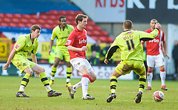 LONDON, ENGLAND - Saturday, January 30, 2010: Charlton Athletic's David Mooney is stopped in his play by a group of  Tranmere  players during the Football League One match at the Valley. (Photo by Gareth Davies/Propaganda)