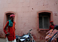 A train employee, left waits to help a traveler outside the train station in Jaipur City india Nov. 15, 2006 Jaipur India.    (photo by Darren Hauck).....................