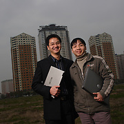 Hoang Minh Son (L) and younger brother Hoang Minh Long (R) near their office in a new business develoment centre filled with hihghrises on the outskirts of Hanoi. The brothers' internet startup San Otc is riding a wave of interest in the burgeoning Vietnamese stock market.