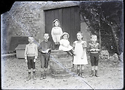 children posing for an image around 1900 broken glass negative