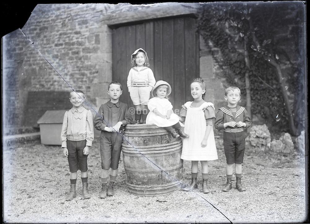 children posing for an image around 1900 broken glass negative