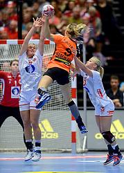 20-12-2015 DEN: World Championships Handball 2015 Nederland - Noorwegen, Herning<br /> De Nederlandse handbalsters streden zondagmiddag om de wereldtitel handbal. Er moest worden afgerekend met Noorwegen, maar de regerend olympisch en Europees kampioen was te sterk: 23-31 / Sanne van Olphen #9,  Veronika Kristiansen #4 of Norway, Stine Oftedal #10 of Norway