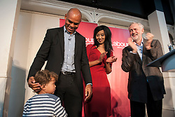 © Licensed to London News Pictures. 15/10/2015. Bristol, UK.  Bristol Mayoral candidate Marvin Rees, Bristol Labour councillor Hibaq Jama, with JEREMY CORBYN, leader of the Labour Party, at a rally for Labour Party members at the Trinity Centre in Bristol, to highlight and oppose the impact of the Governmentís changes to voter registration, expected to remove 1 million voters from the electoral roll by the end of the year. Photo credit : Simon Chapman/LNP