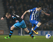 Brighton player Jamie Murphy gets the better of Sheffield Wednesday midfielder Barry Bannan  during the Sky Bet Championship match between Brighton and Hove Albion and Sheffield Wednesday at the American Express Community Stadium, Brighton and Hove, England on 8 March 2016. Photo by Bennett Dean.