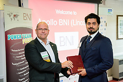 BNI Apollo (Lincoln) chapter president Simon Meadows (Sterling Business Coaching), left, presents the chapters newest member Azam Zia (Chattertons) with his member pack.  Azam is a corporate associate solicitor with Chattertons.  The BNI Apollo chapter meet at Lincoln City's Sincil Bank stadium on Thursday mornings 9.15am - 11am.<br /> <br /> Picture: Chris Vaughan Photography<br /> Date: November 9, 2017