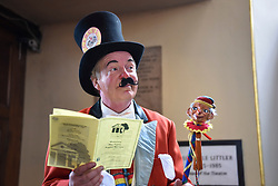 © Licensed to London News Pictures. 13/05/2018. LONDON, UK. A performer listens to a church service at the Covent Garden May Fayre at St Paul's Church, Bedford Street, known as the actors' church.  Now in its 43rd year, Punch and Judy professors and puppeteers celebrate the art of puppetry on Mr Punch's 356th birthday, near to where writer Samuel Pepys first saw Mr Punch in May 1662.  Photo credit: Stephen Chung/LNP