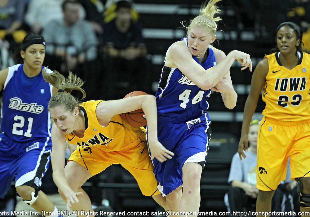 December 20, 2011: Iowa Hawkeyes forward Kelly Krei (20) and Drake Bulldogs forward/center Stephanie Running (44) battle for the ball during the NCAA women's basketball game between the Drake Bulldogs and the Iowa Hawkeyes at Carver-Hawkeye Arena in Iowa City, Iowa on Tuesday, December 20, 2011. Iowa defeated Drake 71-46.