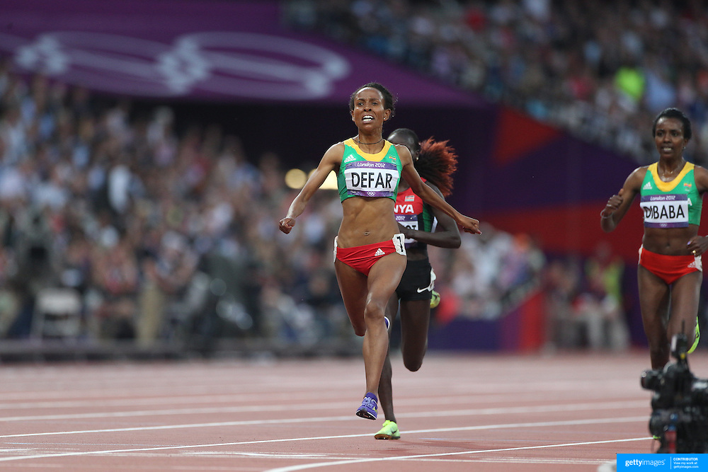 Meseret Defar, Ethiopia, winning the Gold Medal in the Women's 1500m Final with Vivian Jepkemoi Cheruiyot, Kenya, winning Silver and Tirunesh Dibaba, Ethiopia winning Bronze at the Olympic Stadium, Olympic Park, during the London 2012 Olympic games. London, UK. 10th August 2012. Photo Tim Clayton