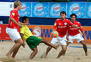 07 December 2006, Brazil's Benjamin da Silva fires a shot goal wards as England's Terrence Bowes looks on during the first game of the Vodacom Pro Beach Soccer Tour at Durban's Bay of Plenty on Thursday. Brazil won the game 10 - 3. Picture: Shayne Robinson, PhotoWire Africa