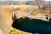 View of the Kariba hydroelectric dam in the Kariba gorge of the Zambezi river between Zimbabwe and Zambia in southern Africa. The dam forms lake Kariba, the world's largest man-made lake