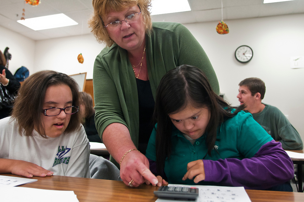 Lathan Goumas | The Bay City Times..Cathy Hamann-Lee helps Allyssa Goretcki (left) and Anna Huizar (right) with a match problem in a classroom at the Bay Campus of the Bay-Arenac Intermediate School District Living Learning Center in Essexville on Wednesday. There is a proposed 20-year 1 mill special education millage increase on the November 8, 2011 ballot that will generate close to $3.5 million to support special education programs in local school districts.