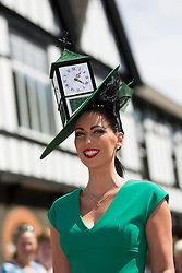 Repro Free 08/08/2013 Suzanne O'Brien winner of the 'Most Creative Hat' at the Blossom Hill Ladies' Day at the Discover Ireland Dublin Horse Show. Pic Andres Poveda