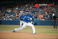 Jul 19, 2014; Toronto, Ontario, CAN; Toronto Blue Jays starting pitcher Marcus Stroman (54) pitches against the Texas Rangers during the 1st inning at Rogers Centre. Toronto won 4 - 1 Mandatory Credit: Peter Llewellyn-USA TODAY Sports