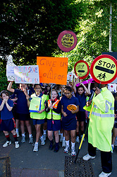 © licensed to London News Pictures. London, UK  05/06/11. Early this morning 400 parents and children from Alleyn's, Dulwich Hamlet and James Allen's Preparatory School, marched through Dulwich to protest about government plans to remove their lollipop men. Children made signs, blew whistles and shouted 'save our lollipop'.  Please see special instructions for usage rates. Photo credit should read Mary Stamm-Clarke/LNP