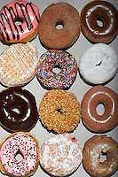 Variety of doughnuts in cardboard box view from above