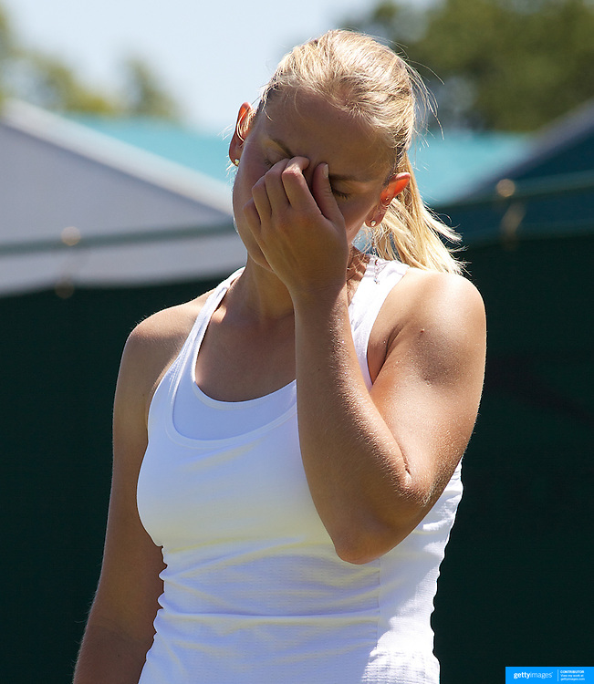 Jelena Dokic, Australia, during her three set loss to Tatjana Malek, Germany during the first round match at the All England Lawn Tennis Championships at Wimbledon, London, England on Tuesday, June 23, 2009. Photo Tim Clayton.