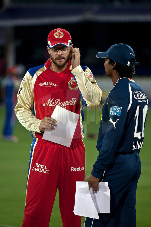 Vettori (R) and Sangakara discussing before team list exchange during match 11 of the Indian Premier League ( IPL ) between the Deccan Chargers and the Royal Challengers Bangalore held at the Rajiv Gandhi International Cricket Stadium in Hyderabad on the 14th April 2011..Photo by Saikat Das/BCCI/SPORTZPICS