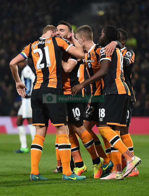 Hull City's Michael Dawson (left) celebrates scoring his side's first goal of the game with team mates during the Premier League match at the KCOM Stadium, Hull.