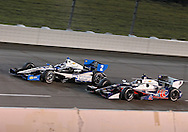 Marco Andretti (26) and Ryan Briscoe (2) race side by side during the IZOD IndyCar Iowa Corn Indy 250 auto race at the Iowa Speedway in Newton, Iowa on Saturday, June 23, 2012.
