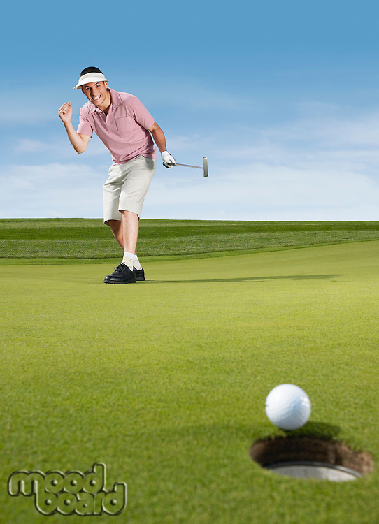 Golfer cheering after putting