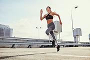 Poland, West Pomerania, Szczecin - Woman doing running exercises in the city