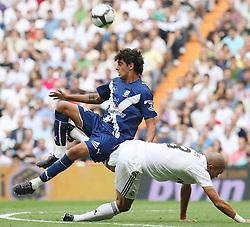 Tenerife's Roman (l) and Real Madrid's Pepe during La Liga match.September 2 2009.