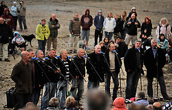 © Licensed to London News Pictures. 26 August 2011. Port Isaac, Cornwall. The Fisherman's Friends perform in their home village of Port Isaac in Cornwall. The tour manager for the Cornwall-based Fisherman's Friends male singing group has been killed in an accident at a Surrey music venue. Paul McMullen died and Trevor Grills, one of the singers, suffered serious head injuries when a large metal door fell at G Live in Guildford.. Photo credit : MarkHemsworth/LNP
