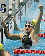 New Zealand's Moss Burmester celebrates after winning gold in the mens 200m butterfly final during the swimming at the Melbourne Sports & Aquatic Centre on day one of the XVIII Commonwealth Games, Melbourne, Australia, Thursday, March 16 2006. Photo: Michael Bradley/PHOTOSPORT<br /><br /><br /><br />149768