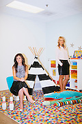 Kelly Sawyer Patricof and Norah Weinstein (brunette) pose for a portrait in a play room for children at the Baby2Baby headquarters in Beverly Hills, California March 2, 2015.