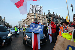 © Licensed to London News Pictures. 31/10/2019. London, UK. Anti-Brexit protesters block traffic as they gather in Parliament Square on what would have been the United Kingdom's last day as a member of the European Union. The date of Brexit had been moved to January 31, 2020 after MPs failed to pass Prime Minister Boris Johnson's withdrawal agreement. Photo credit: Rob Pinney/LNP