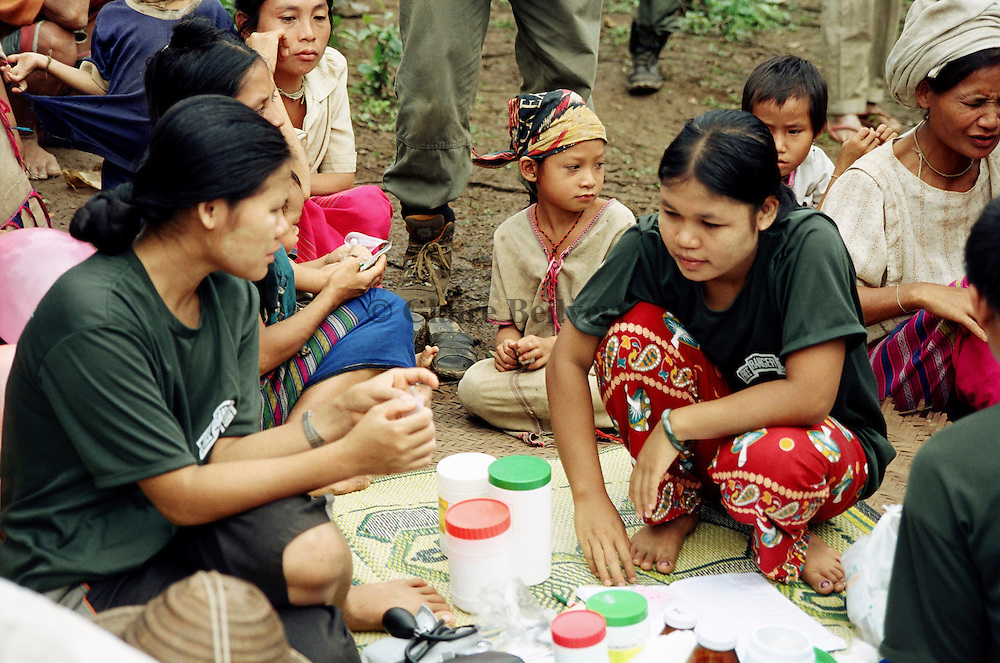 Karen relief workers on a mission in a remote village. The KNLA tries to organise relief missions in remote places. More than 500 000 Karen IDPs are hidding in Burma. This ethnic minority is harrassed by burmese junta and soldiers. They have to hide in remote villages and they receive no food, education or medical support. Only once or twice a year they receive support from KNLA relief team.