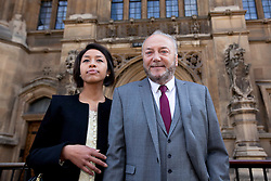 © Licensed to London News Pictures. 16/04/2012. LONDON, UK. George Galloway and his wife, Putri Gayatri Pertiwi, stand outside the houses of Parliament ahead of Mr Galloway being sworn in as the Respect Party's MP for Bradford West. Photo credit: Matt Cetti-Roberts/LNP