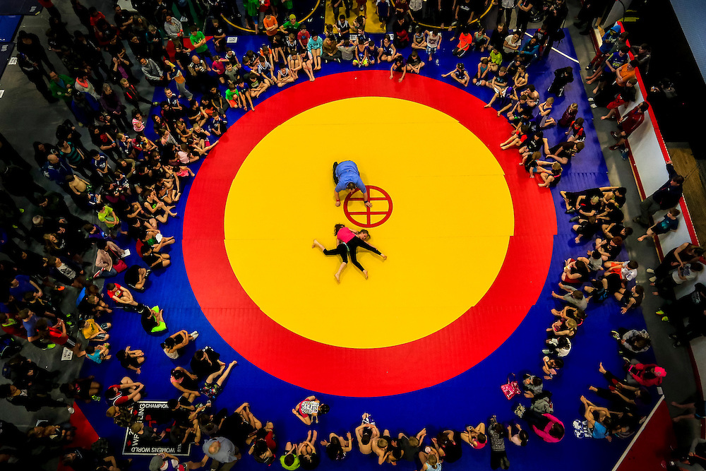 Two high-school wrestlers battle it out on the mat during the Yukon Wrestling Championships. Over 450 students from around the territory converged at the Canada Games Centre to compete in the tournament.