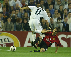 MADRID, SPAIN - Tuesday, April 8, 2003: Manchester United's Gary Neville takes out Real Madrid's Ronaldo  during the UEFA Champions League Quarter Final 1st Leg match at the Estadio Santiago Bernabeu. (Pic by David Rawcliffe/Propaganda)
