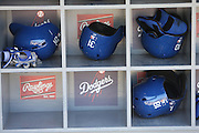 LOS ANGELES, CA - JUNE 17:  Batting helmets are stored in dugout bins during batting practice before the Los Angeles Dodgers game against the Colorado Rockies at Dodger Stadium on Tuesday, June 17, 2014 in Los Angeles, California. The Dodgers won the game 4-2. (Photo by Paul Spinelli/MLB Photos via Getty Images)