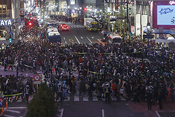 October 31, 2018 - Tokyo, Japan - Costumed partygoers gather during Halloween celebrations at Shibuya's famous scramble crossing in Tokyo. People gather to celebrate Halloween every year in Shibuya's famous scramble crossing and Roppongi area. Police presence controlling pedestrian access to avoid the risk of traffic accidents and other incidents. (Credit Image: © Rodrigo Reyes Marin/ZUMA Wire)