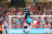 Sheffield Wednesday Midfielder Barry Bannan celebrates the third goal \by Sheffield Wednesday Forward Lucas Joao during the Sky Bet Championship match between Brentford and Sheffield Wednesday at Griffin Park, London, England on 26 September 2015. Photo by Phil Duncan.