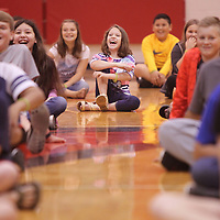 Adam Robison | BUT AT PHOTOS.DJOURNAL.COM<br /> Issabella Ragan, a fifth grader at Belmont Elementary School, laughs as part of an exercise with Coach Calhoun as he leads the group in the Move to Learn program Wednesday mornig in Belmont.