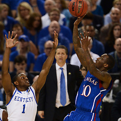 Apr 2, 2012; New Orleans, LA, USA; Kansas Jayhawks guard Tyshawn Taylor (10) shoots over Kentucky Wildcats guard Darius Miller (1) during the first half in the finals of the 2012 NCAA men's basketball Final Four at the Mercedes-Benz Superdome. Mandatory Credit: Derick E. Hingle-US PRESSWIRE