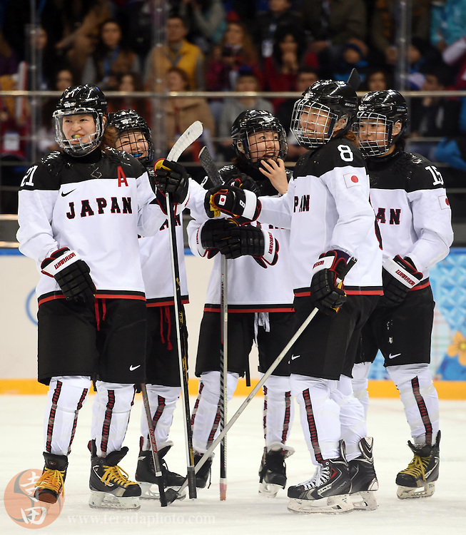 Feb 16, 2014; Sochi, RUSSIA; Japan forward Rui Ukita (15) celebrates with teammates after scoring a goal against Russia in a women's ice hockey classifications round game during the Sochi 2014 Olympic Winter Games at Shayba Arena.