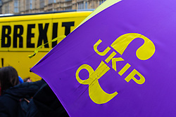 """The logo of populist right wing party UKIP on an umbrella and """"Brexit"""" - what the party existed for. London, January 15 2019."""